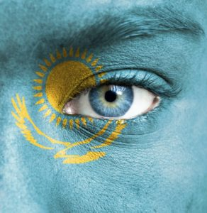 Human face painted with flag of Kazakhstan-web