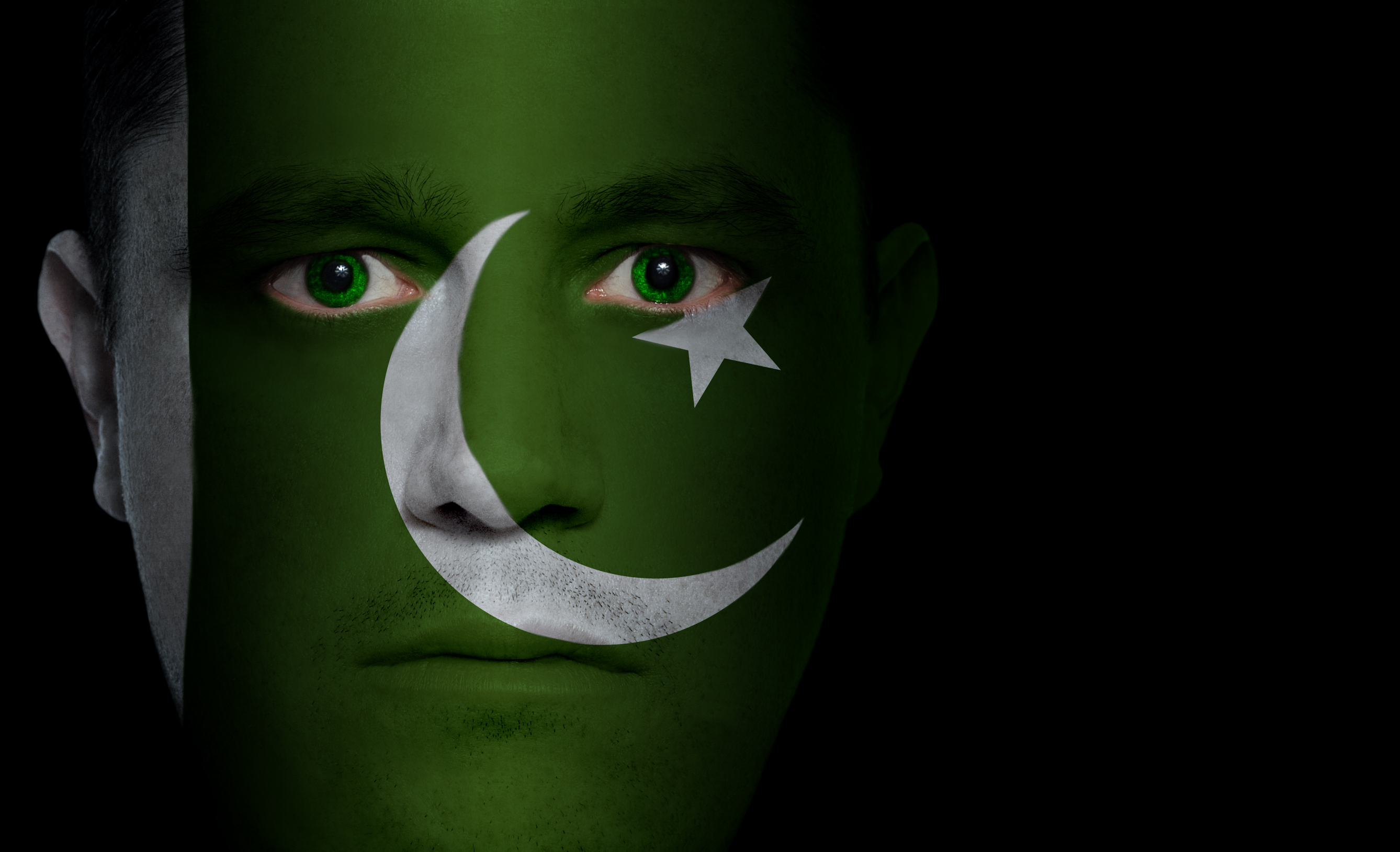 Urdu Translation Services- Flag of Pakistan projected onto a man's face