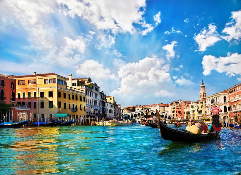 Italian Translation Services Venice Grand canal with gondolas and Rialto Bridge, Italy in summer bright day