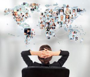 woman looking at world map-web