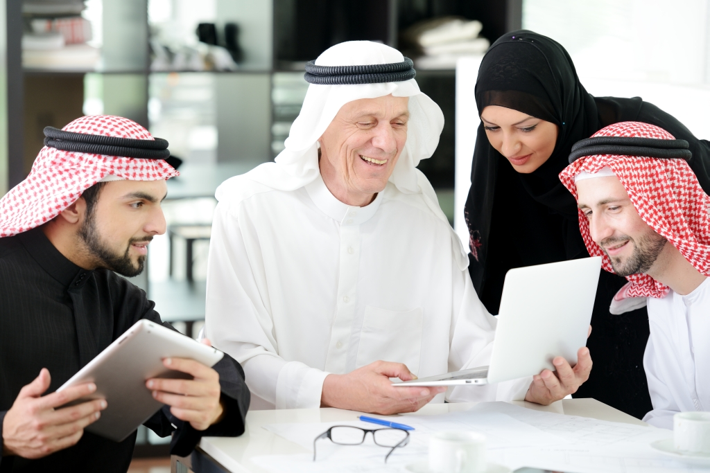 Business arabic people meeting indoor with electronic tablet-web