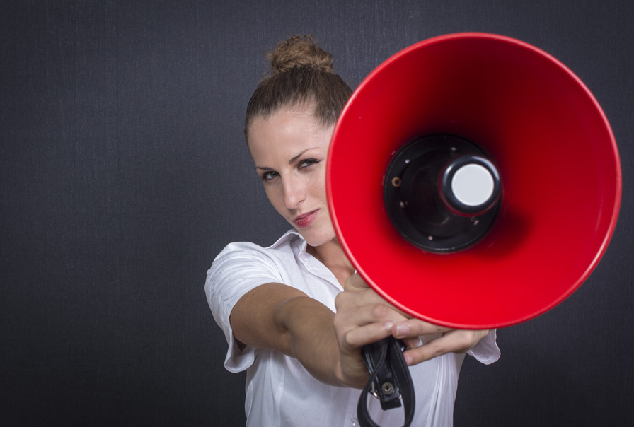 A woman holds a hailer Telephone service